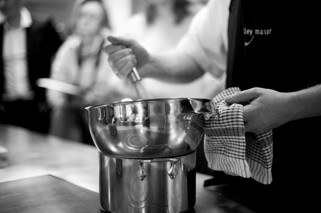 Whisking in All Clad prep bowl over pan